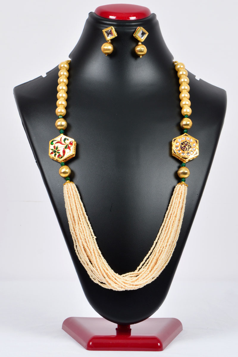 Off White Color Pearl Neckpiece emblished with Simultated Gold Plated Work and Beads with a set of Tear Drop Earrings - MCJ250115