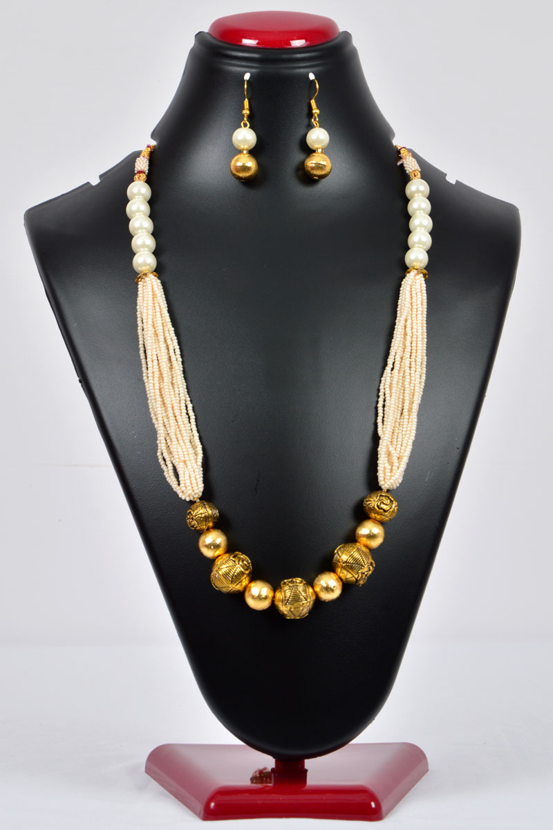 White Color Pearl Neckpiece emblished with Gold Plated Work and Multiple Beaded Chains and with a pair of Dangle Earrings - MCJ250116